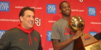 Steve Lavin and JaKarr Sampson pose with the Rookie of the Year trophy.