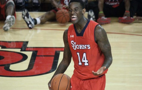 Johnnies fall to Wisconsin in opener
