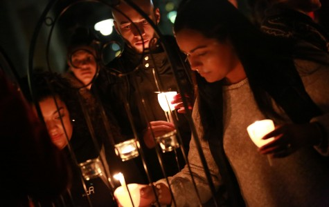 Light for Peace: Students hold candlelight vigil after terrorist attacks and natural disasters