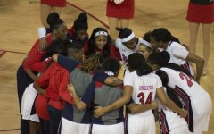 Walker's milestone highlights women's basketball break