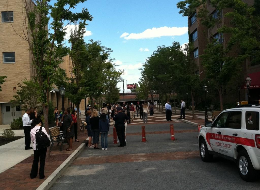 People+gather+outside+Carnesecca+Arena+after+evacuating+Campus+buildings+in+the+wake+of+an+earthquake.