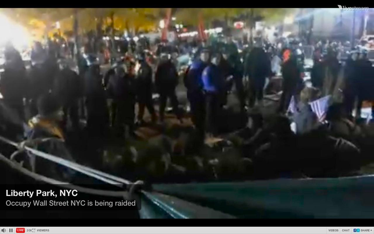 Police gather in Zuccotti Park to clear protesters.