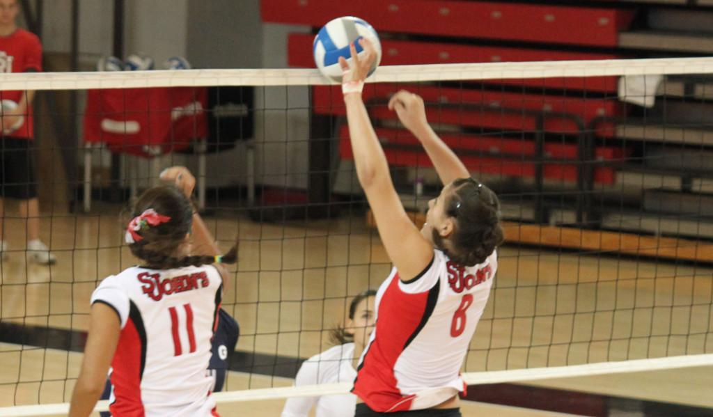 Johnnies Sweep Huskies Aside