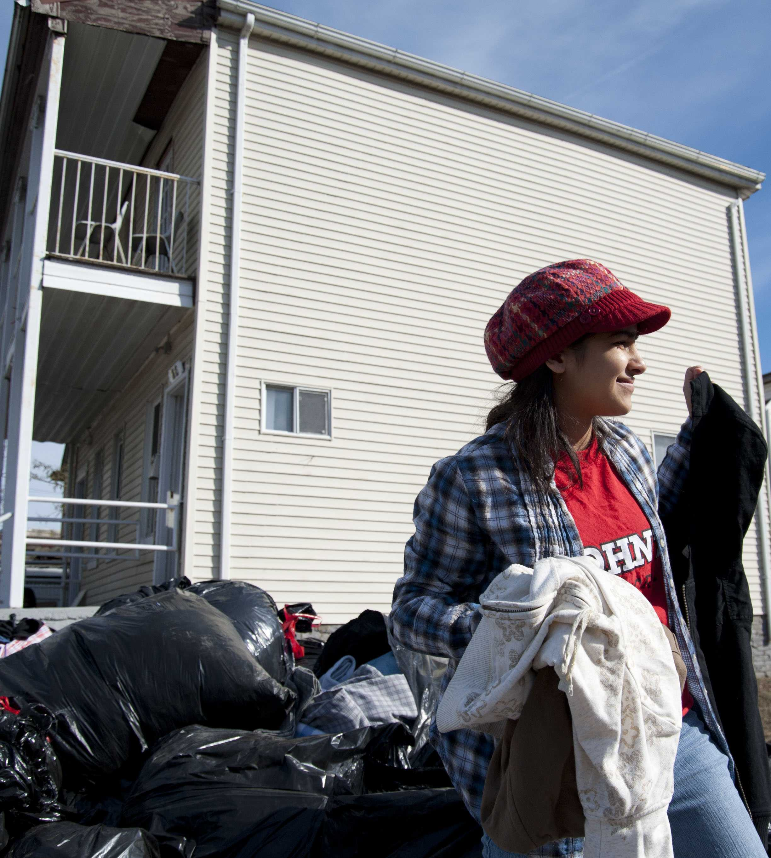A St. John's student helps organize the clothes being dropped off for donations in Far Rockaway, NY.