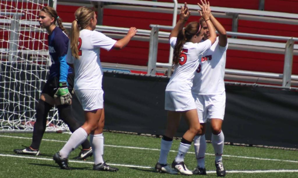 Rachel+Daly+is+congratulated+by+her+teammates+after+scoring+one+of+her+three+goals.