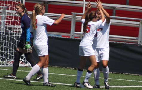 Rachel Daly is congratulated by her teammates after scoring one of her three goals.