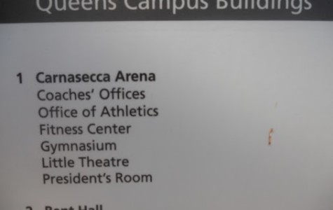Signs throughout campus misspell Lou Carnesecca's name.