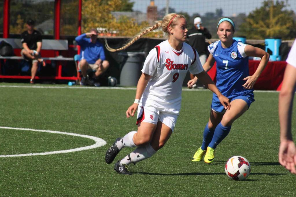 Freshman Lara Kristin Pederson looks to clear the ball from St. John's box.
