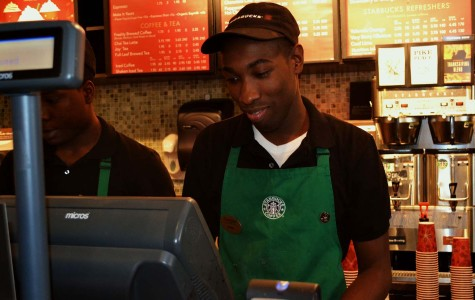 Java John serves up coffee and the occasional beat to customers at Starbucks.