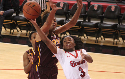 Aliyyah Handford cuts to the basket as a sets a career high 32 points against Iona.