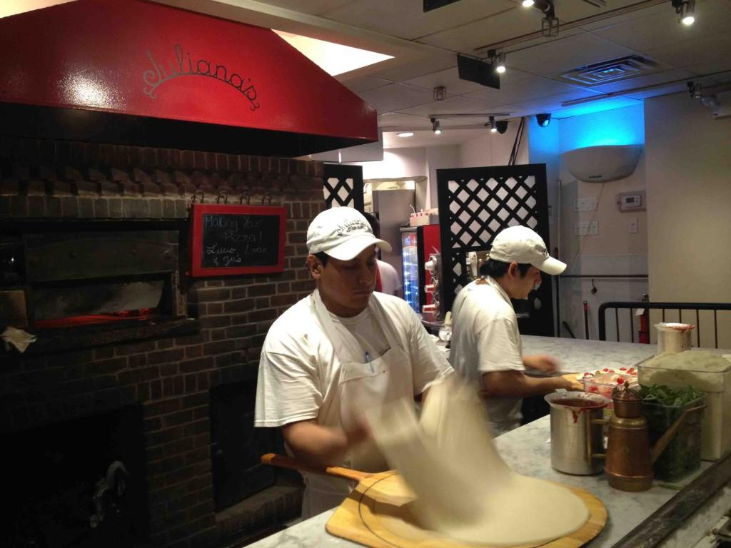 Pizza makers at Juliana's Pizza are hard at work serving up delicious pizza pies.