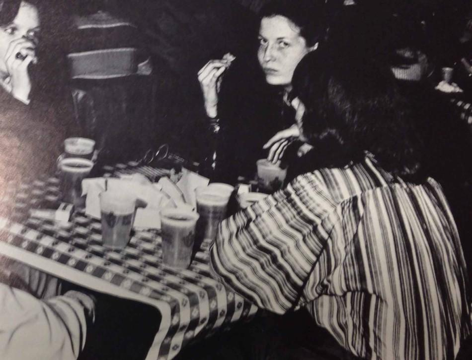 Students in the 70s socializing in the Rathskellar enjoying snack foods and beer.