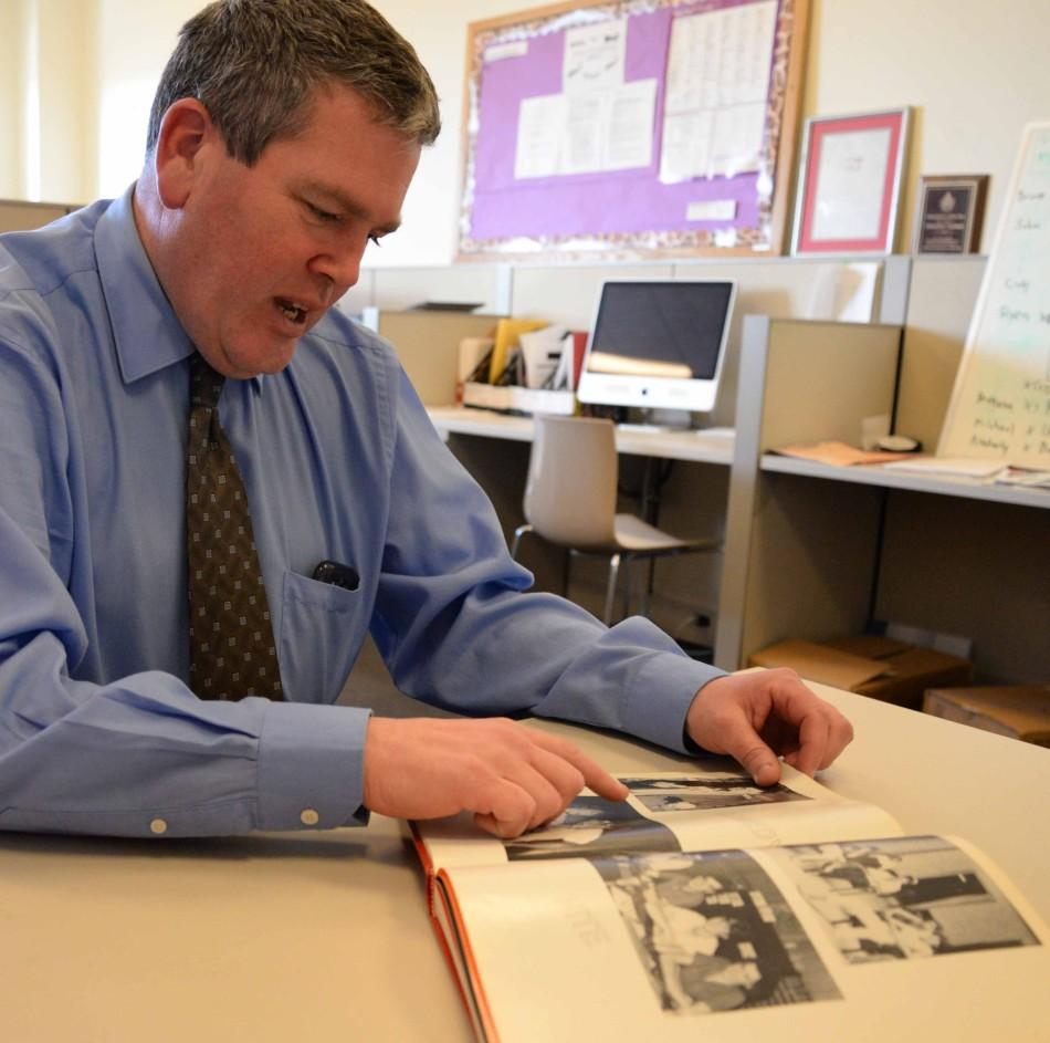 Michael Brady, former SGI president, shows the Torch his yearbook with pictures from the Rathskellar.