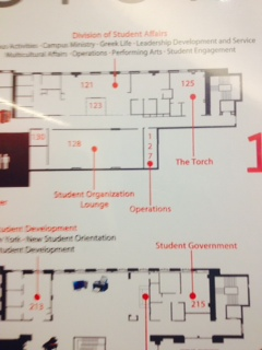 A floor plan found in the D'Angelo Center shows the location of the two rooms. The current office is room 125 and is labeled