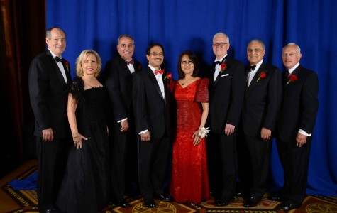 """Attendees pose with the president and his wife at the annual President's Dinner. L to R: William Collins and Lesley Collins, dinner co-chairs; honoree Kevin Reed; University President Dr. Conrado """"Bobby"""" Gempesaw; Clavel Gempesaw; honoree Anthony Butler; Peter D'Angelo, Chair of the Board of Trustees; and honoree James Riley, Jr. Photo provided by St. John's University"""