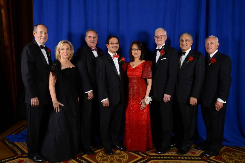 "Attendees pose with the president and his wife at the annual President's Dinner. L to R: William Collins and Lesley Collins, dinner co-chairs; honoree Kevin Reed; University President Dr. Conrado ""Bobby"" Gempesaw; Clavel Gempesaw; honoree Anthony Butler; Peter D'Angelo, Chair of the Board of Trustees; and honoree James Riley, Jr. Photo provided by St. John's University"