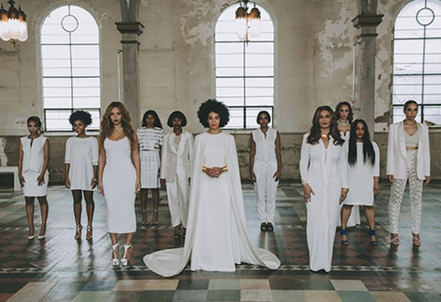 Solange+Knowles+decked+out+in+a+white+gown+with+attached+cape+designed+by+Humberto+Leon+for+Kenzo%2C+posed+alongside+her+bridal+party+in+the+New+Orleans+Museum+of+Art.+