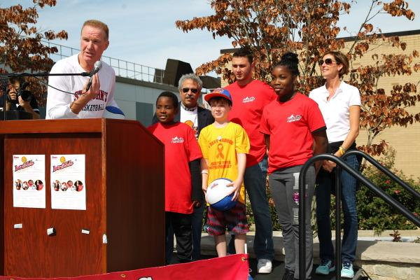 Men's basketball head coach Chris Mullin introduces pediatric cancer survivors at the fifth annual Dribble for the Cure. (Photo: Athletic Communications)