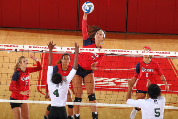 SJU honors cancer surviors, splits weekend matches