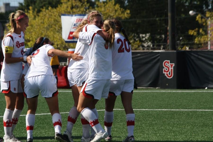 Emily+Cubbage+celebrating+with+her+teammates+after+she+scored+a+highlight+reel+goal+in+the+66th+minute+versus+Marquette+as+she+headed+in+a+corner+kick+from+junior+Morgan+Tinari.