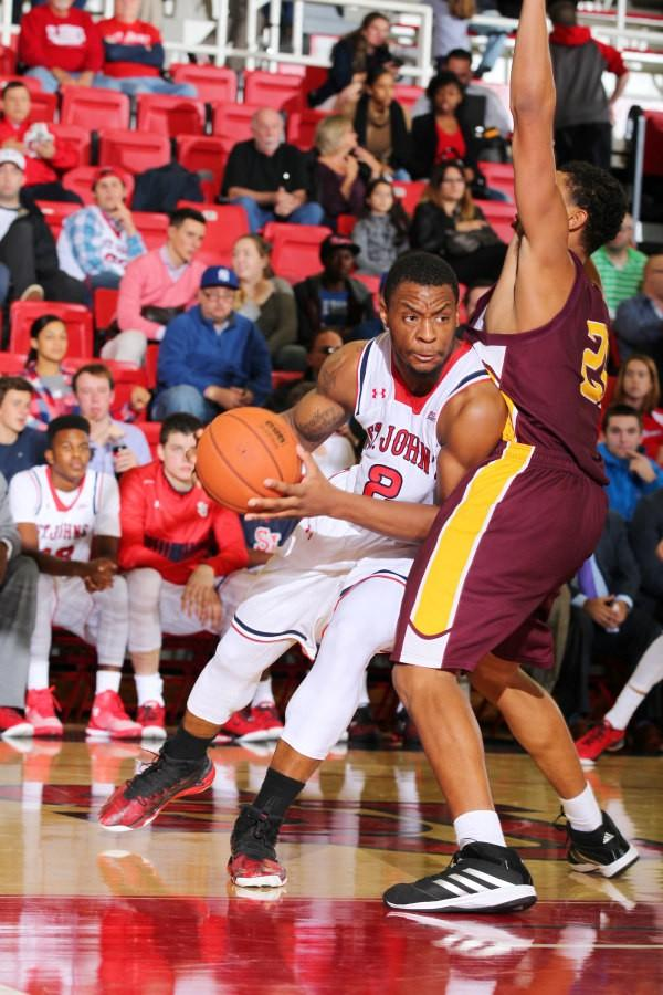 Christian Jones was one of the few bright spots for St. John's as the redshirt junior scored 13 points, grabbed 11 rebounds and had four steals in the exhibtion loss to Division II Thomas Aquinas. (Photo: St. John's Athletic Communications)