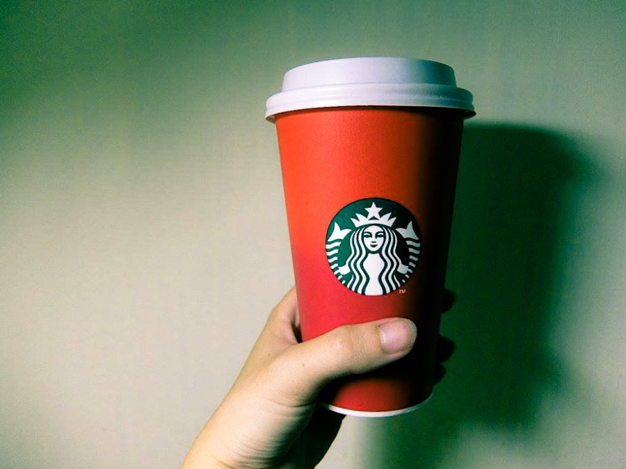 Starbucks red holiday cups offer a minimalist design where a bright red fades off into a darker shade, different from winter snowflakes, reindeer and snowmen drawings from previous years.