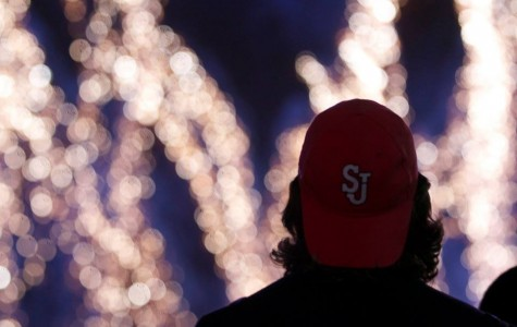 Student looks up at fireworks during the Dec. 7 Christmas Light Spectacular event.