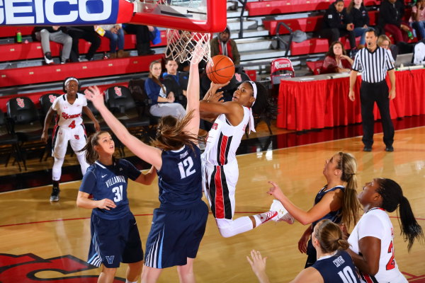Aliyyah Handford (3) absorbs contact and attempts the layup in the Red Storm's 71-59 loss to Villanova on Feb. 12, 2016. (Photo: St. John's Athletic Communications)