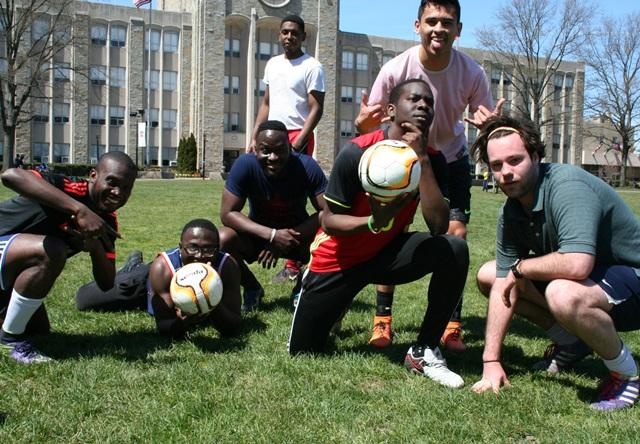 Soccer players pose with Fair Trade Certified soccer balls during mini tournament.