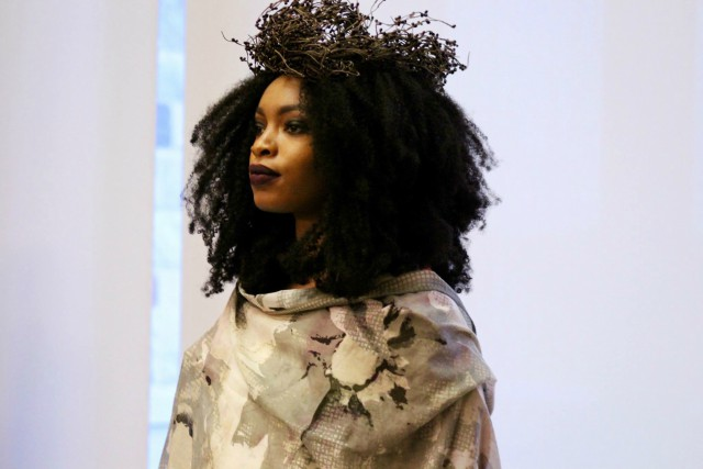 Junior Izzy Odigie models for Ben Achille's art exhibition, which was a representation ofneach of his models' reflection in the Garden of Eden.