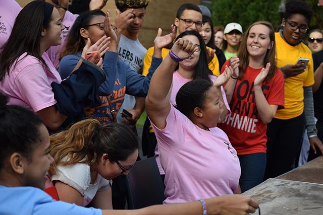 Students cheered on the participants of the pie eating contes during the annual Battle of the Buildings event on Queens campus.