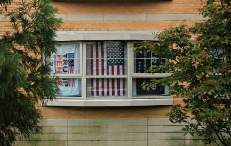 The students in a Century Hall suite have put up their flags supporting President-elect Donald Trump since his victory on Nov. 9, causing controversy on campus.