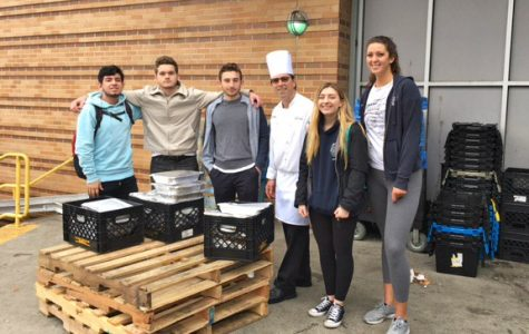 Student volunteers pose with Chef Kelly Heefner before taking donated food to local food pantry.