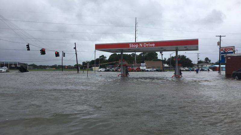 A gas station became inaccesible due to  rising floodwaters.