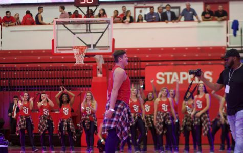 Matthew Kirschenheiter, freshman, does a dance routine on the basketball court for this year's Tip-Off.