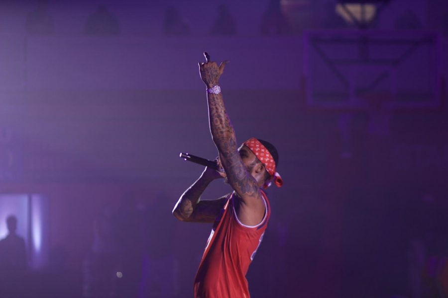 Rapper Dave East displays an obscene gesture during St. John's annual Red Storm Tip-Off event, which he said was