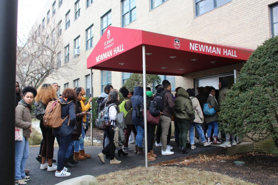 Students walk into Newman Hall during a protest in February