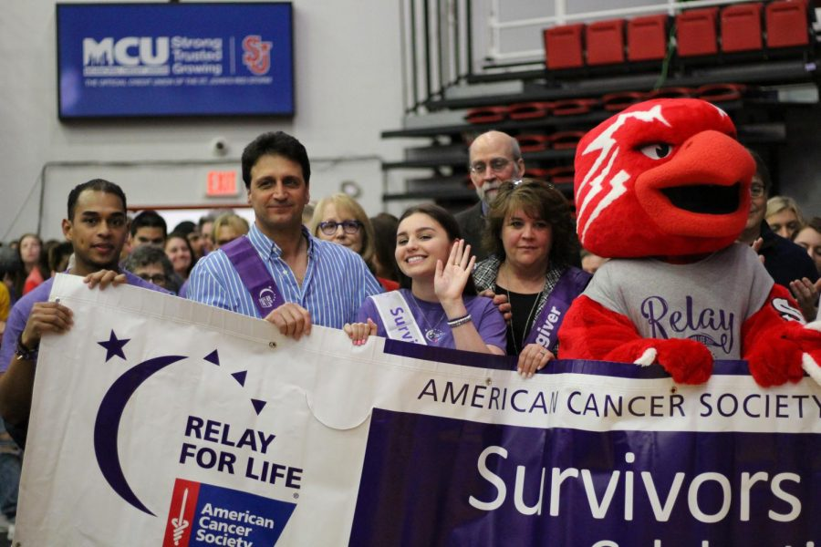 Natalie Collura, a cancer survivor, walked with the SJU community at Relay for Life on Friday.