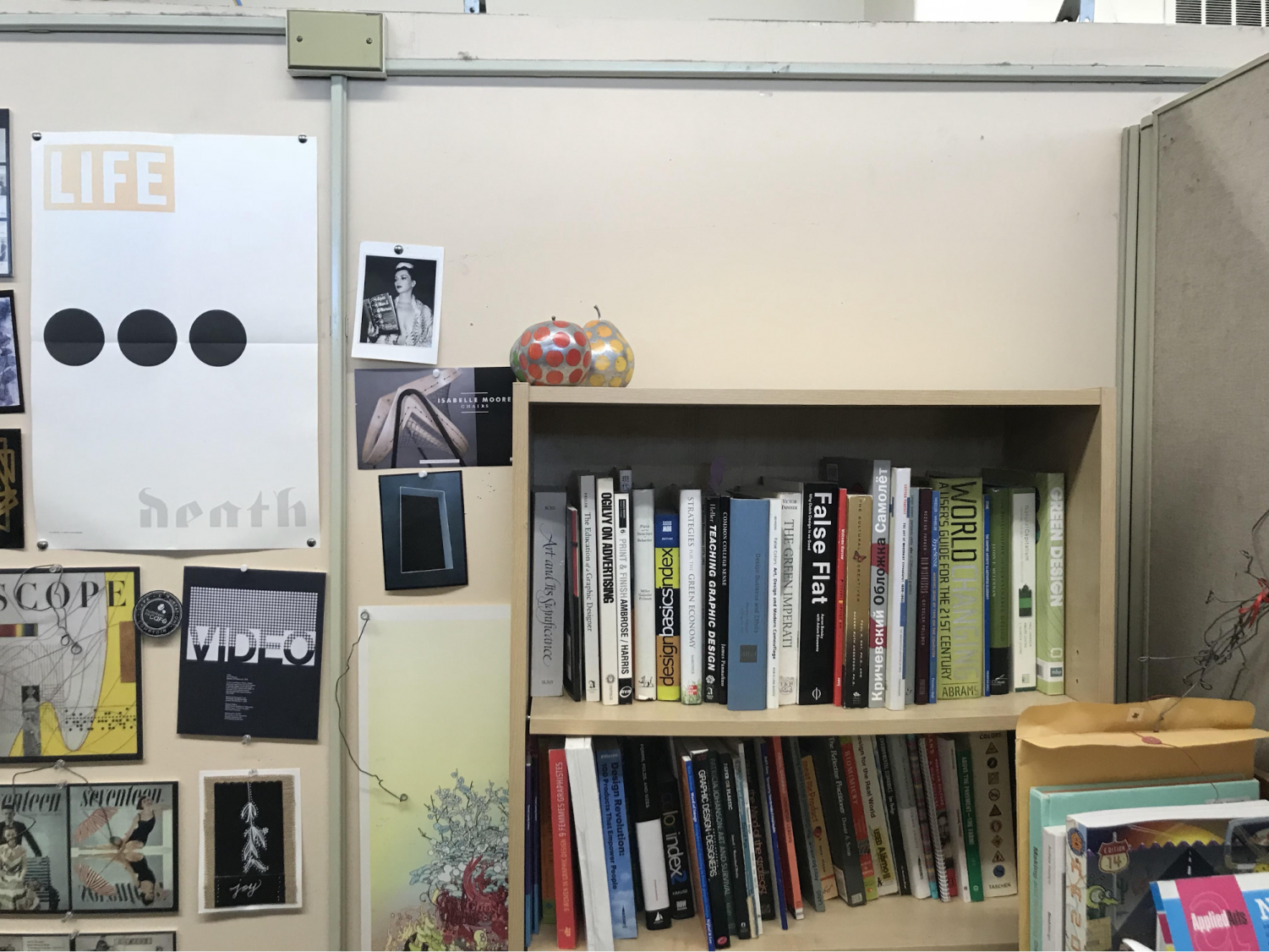 Professor Aaris Sherin's office with the 16 books that she discovered missing on April 11 were stacked atop this bookshelf.