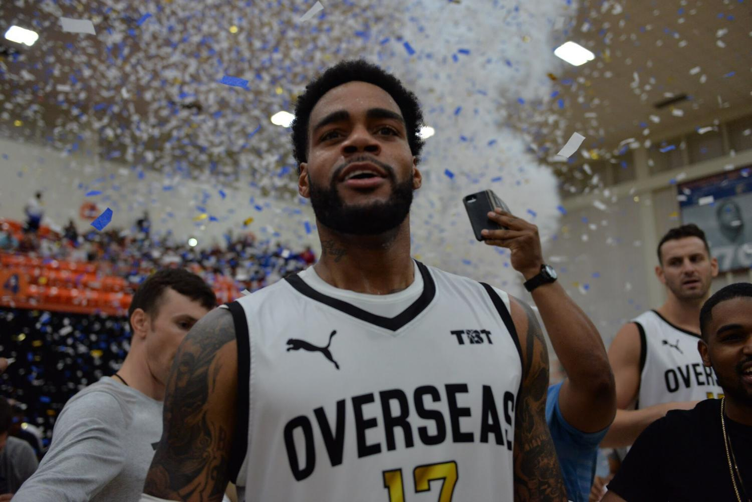 D.J. Kennedy celebrates after Overseas Elite captures their fourth straight championship