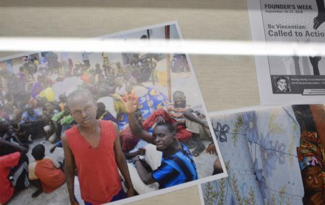 An exhibition photo of a young boy in Senegal posing at a gathering.