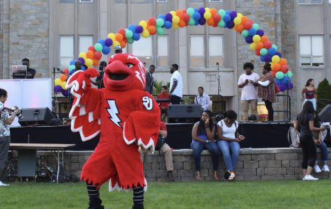 St. John's University mascot, Johnny, dancing on the great lawn during the September 2017 multicultural mixer