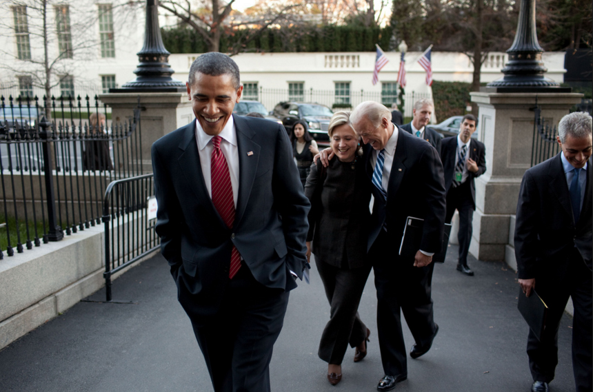 Barack Obama, who was also a recipient of the packages walking to the Eisenhower Executive Office with Hillary Clinton and Joe Biden.