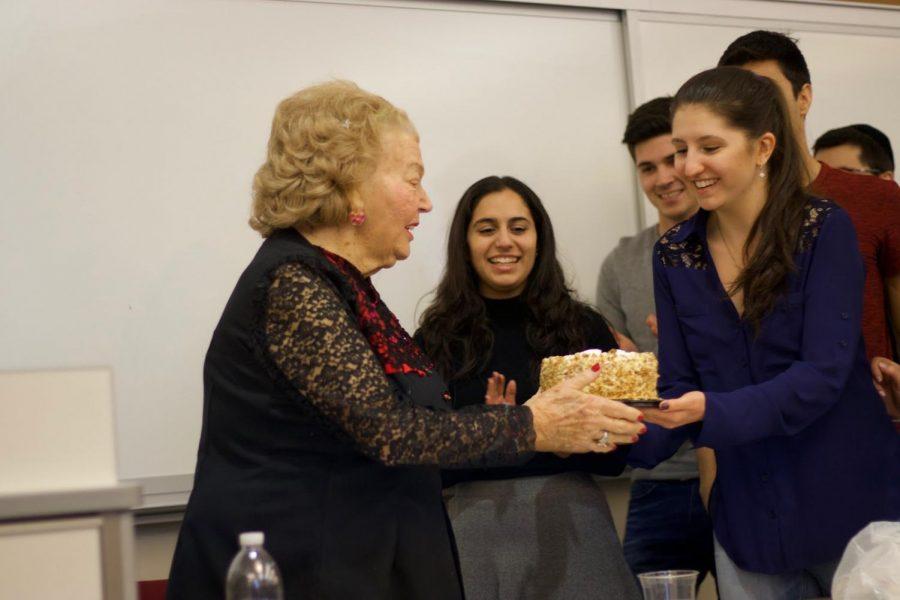 Svetlana+Bachayev+hands+Lena+Goren+a+birthday+cake+to+celebrate+her+89th+birthday.