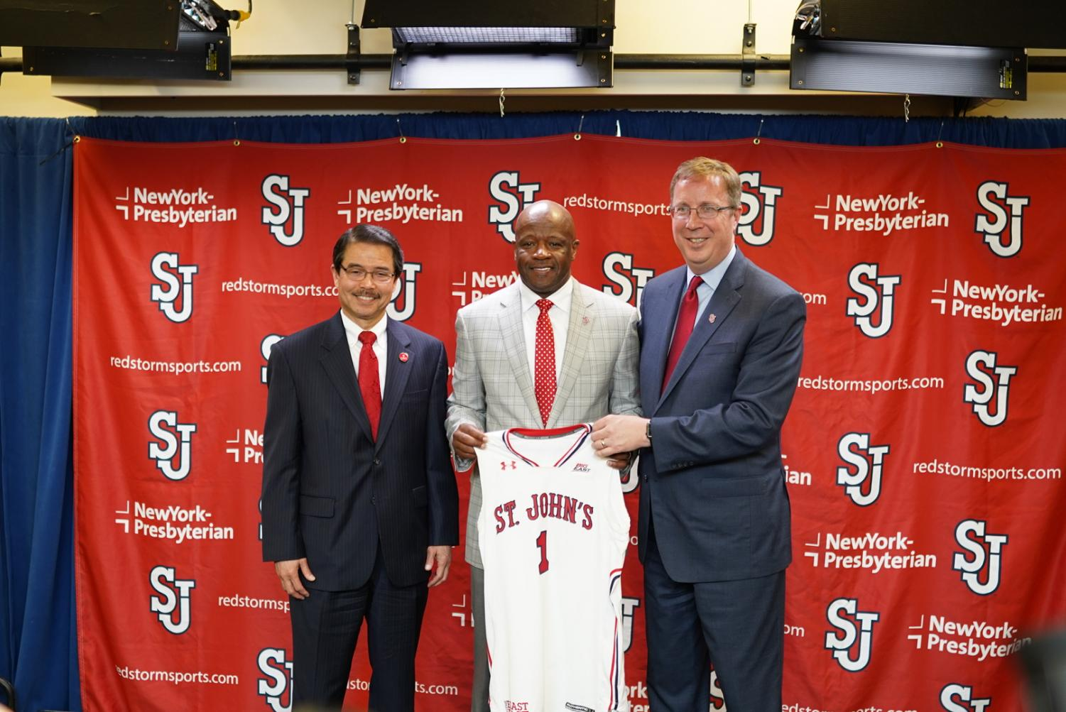 "Left to right) University President Conrado ""Bobby"" Gempesaw, head coach Mike Anderson and Athletic Director Mike Cragg pose for a picture."