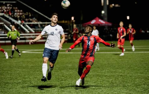 Tani Oluwaseyi fights for a ball during the Red Storm's 3-0 loss to Georgetown Wednesday night.