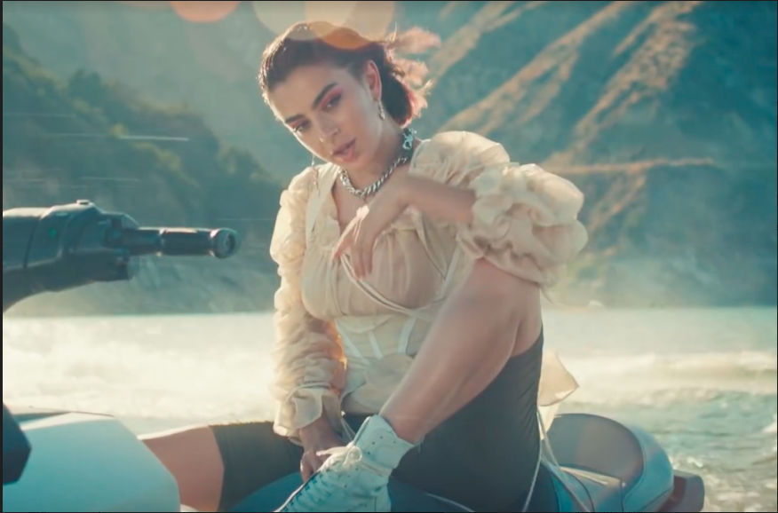 "Charli XCX in her official music video for ""2099,"" feat. Troye Sivan."